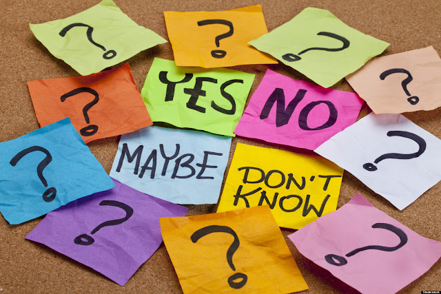 Post It notes with questions marks and answers - making decisions