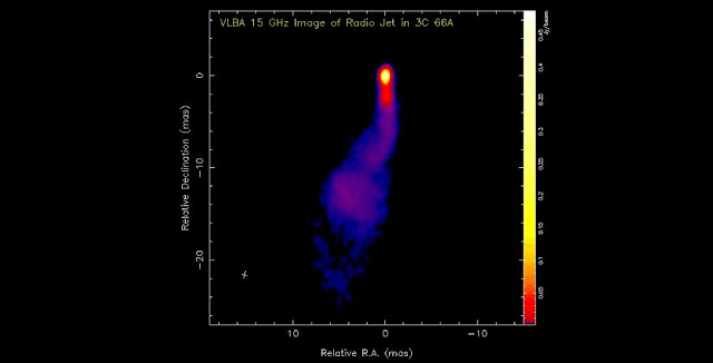 The expulsion of hot plasma in remote quasars as seen in radio waves with a resolution better than 1 milliarcsecond. The luminosity is reflected by the colors used, with yellow corresponding to higher and blue to lower levels. Graphic courtesy of Y. Kovalev and the MOJAVE collaboration.