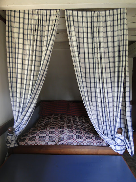 blue check curtains on four poster bed
