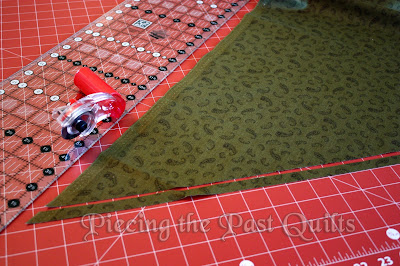 On the bias, cut strips twice the size of the bias tape you want to make.