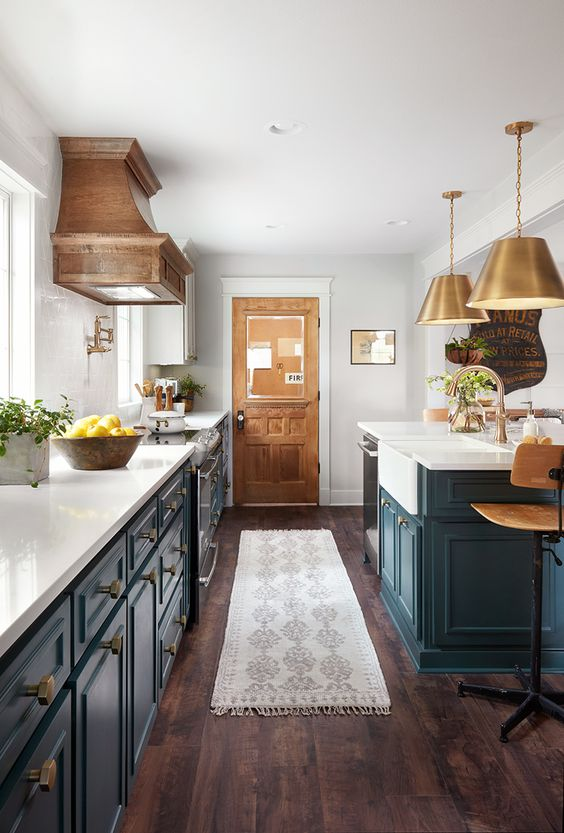 Modern farmhouse kitchen with dark teal cabinets
