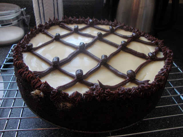 Cappicuno Fudge Cheesecake With Brown And White Frosting