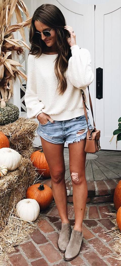 white sweater + denim shorts + bag + boots