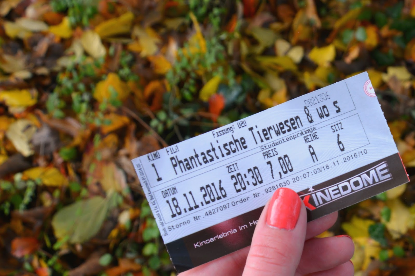 movie ticket Fantastic Beasts; autumnal background