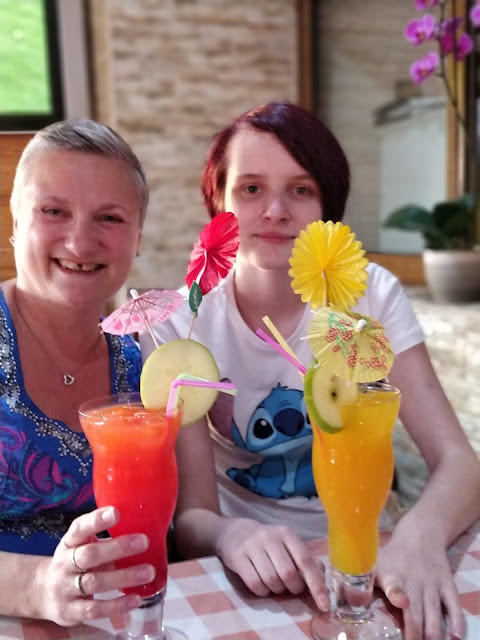 madmumof7 and daughter drinking cocktails in Cyprus