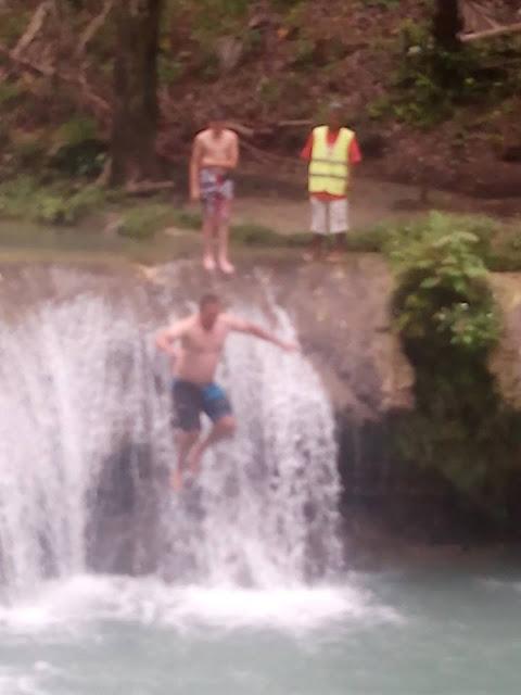 Jumping off Cambugahay Falls