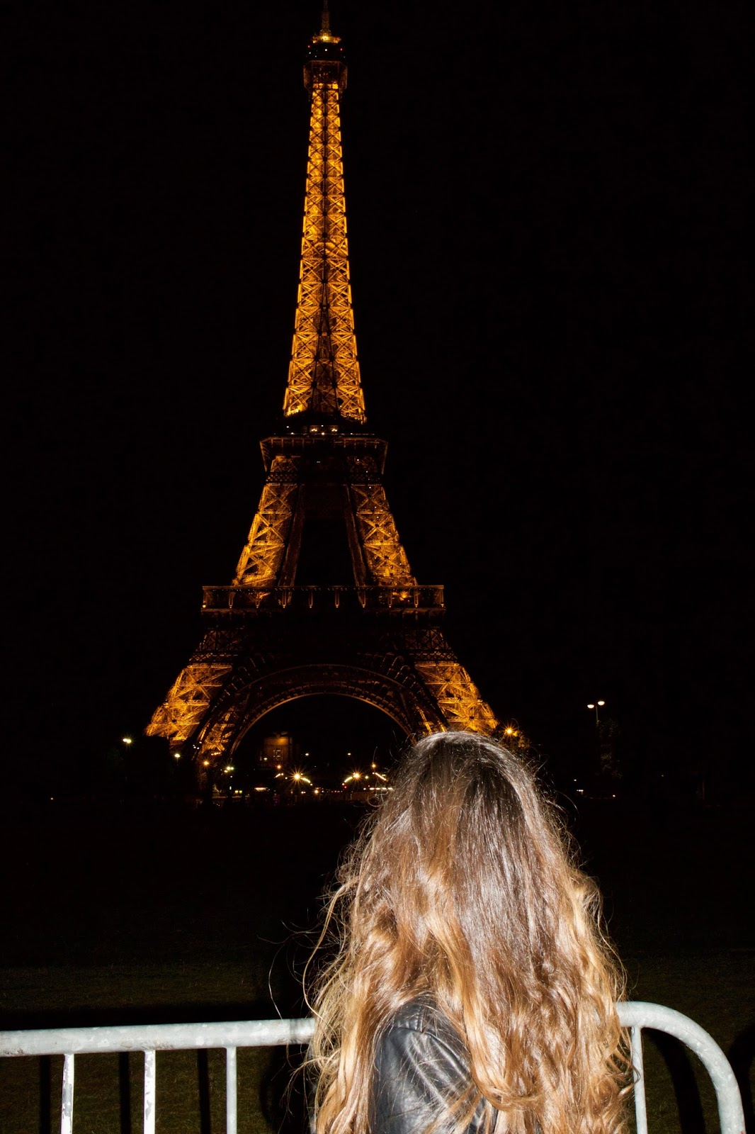 Fashion blogger Kathleen Harper at the Eiffel Tower at night in Paris
