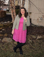 an outfit with a pink dress, striped jacket, black tights, and black booties