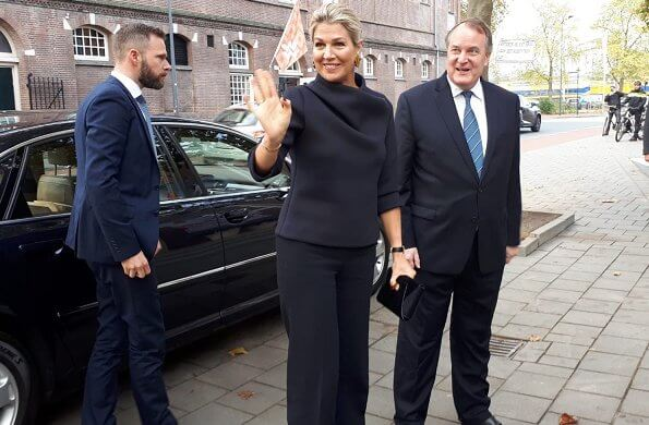 Queen Maxima visited Verkadefabriek in s-Hertogenbosch city. Susanne Friis Bjørner gold earrings and Natan top and pants