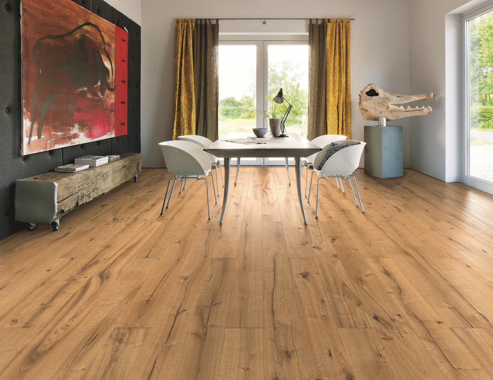When should real wood floors be installed?