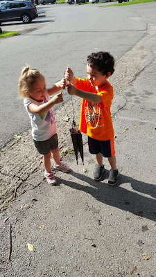 Mikey and Ella examine the day's catch