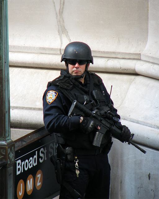 NYPD officer on guard, Broad Street at Wall Street, New York