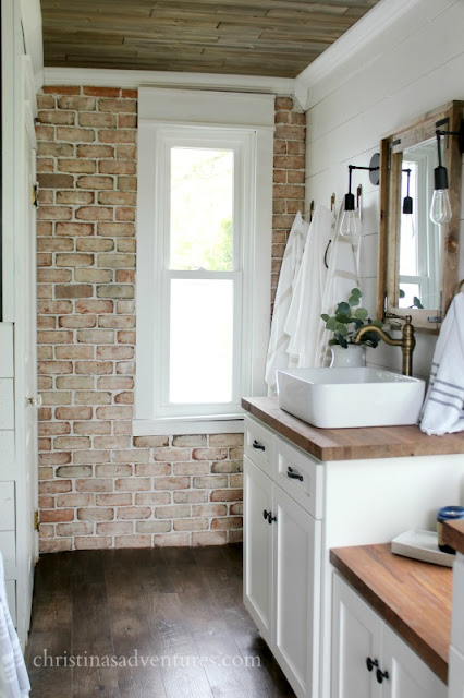 white shiplap and brick wall bathroom