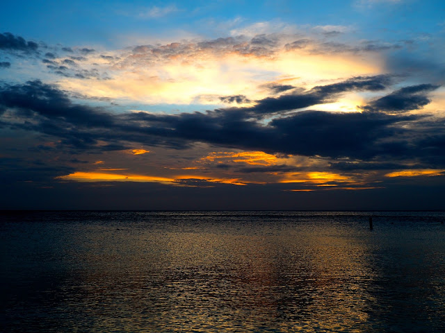 Cloudy sunset sky over the ocean from West Bay Beach, Roatan Island, Honduras