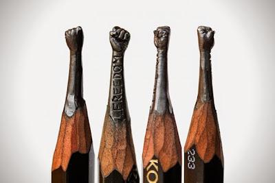Micro Escultura de brazos en la punta de un lápiz