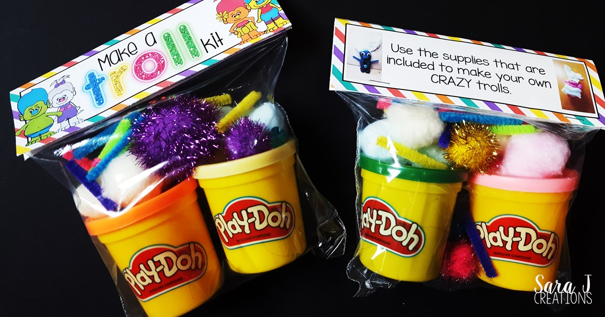 Make a Troll kit includes a FREE printable bag topper for you.  Add some playdough, cotton balls and decorations and you are ready to make some trolls.  Makes the perfect troll themed birthday goody bag.