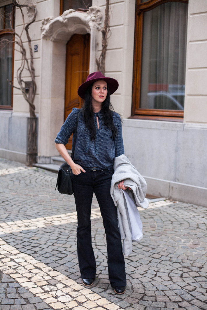 Outfit: flared denim, pussybow blouse, wide brim hat