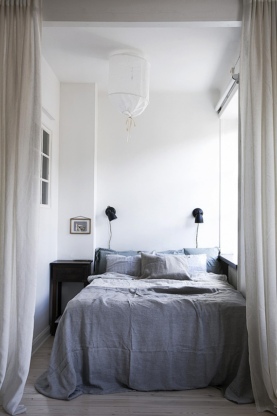 Studio apartment with curtain dividers for the bedroom via Fantastic Frank