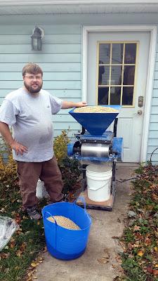 Eric Sanders milling the grain for Adam.