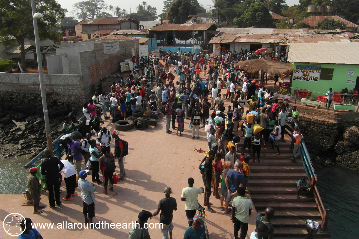 Crowd awaiting departure of the boat to Bissau on the dock of Bubaque Island, Bijagos Archipelago, Guinea Bissau, West Africa