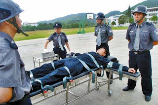 Chinese police officers rehearsing lethal injection procedures