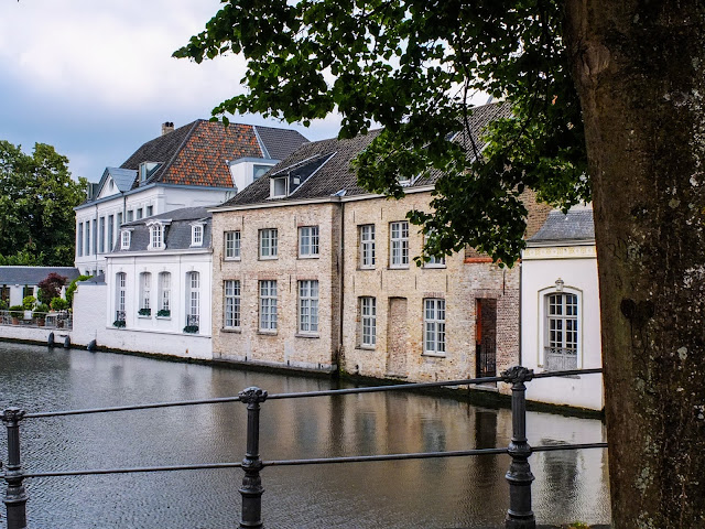 Medieval buildings on a canal in Brugee, Belgium.