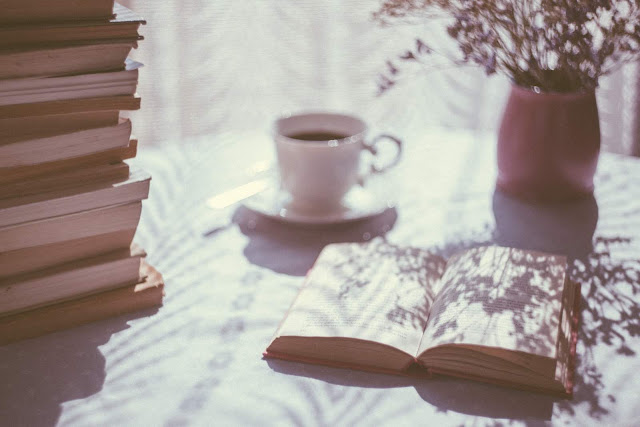 Book, vase, plant and coffee | Photo via Unsplash