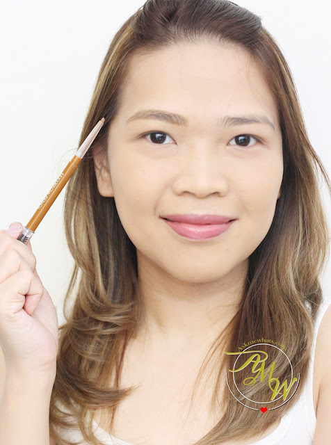 a photo of AskMeWhats Nikki Tiu wearing Cathy Doll Sexy Eyebrow Pencils