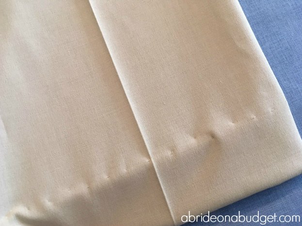 If your dress pants are a little long, you'll want to hem them. Find out how to blind hem your dress pants for a wedding in this post from www.abrideonabudget.com.