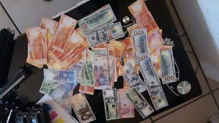 Photos: South African Police arrest Nigerian man found in possession of huge stash of counterfeit money