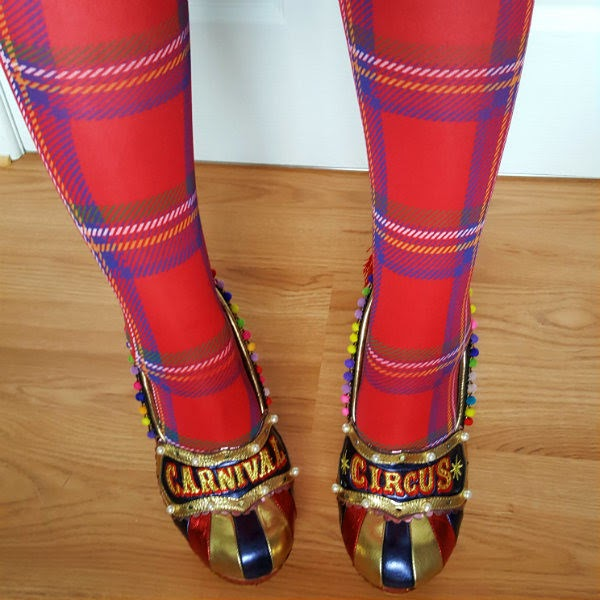metallic striped circus themed shoes being worn with red tartan tights