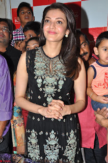 Kajal Aggarwal in lovely Black Sleeveless Anarlaki Dress in Hyderabad at Launch of Bahar Cafe at Madinaguda 002.JPG