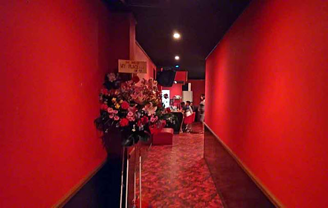 red walls, red floor, hallway, bar,flowers