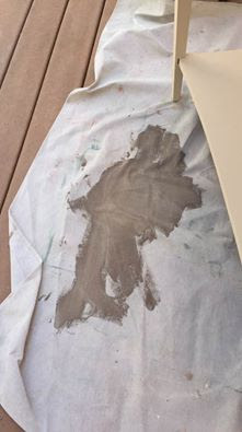 Spilled paint on drop cloth