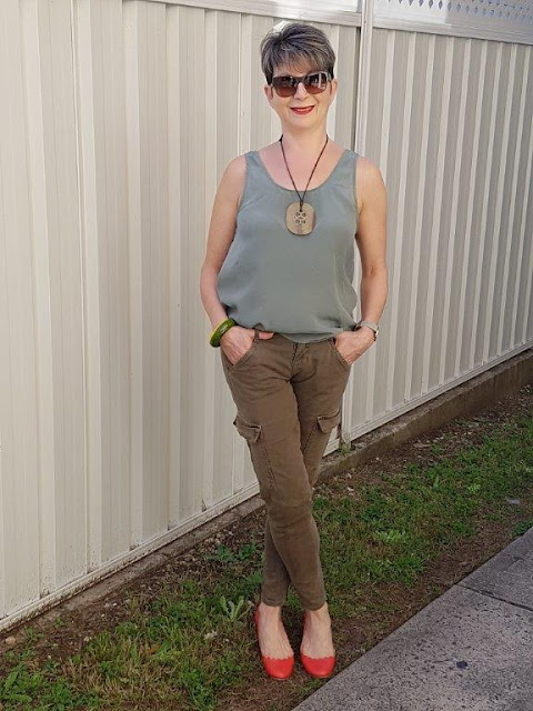 Green cargo pants-green sleeveless top-red shoes