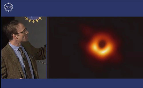 Shep Doeleman, EHT Director, shows image of M87 Black Hole (Source: NSF News Conference, April 10, 2019)