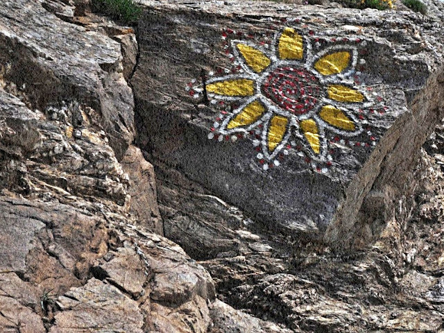 Sunflower painted on a cliff
