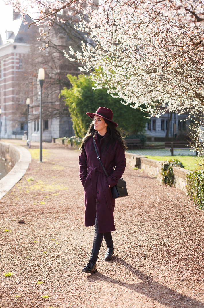 Outfit: robe coat and hat under the first spring blossoms