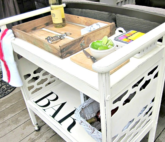 Creating a fun rolling bar cart from a found tv stand.