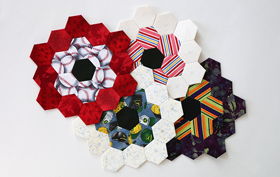 4 Hand Sewn EPP Hexagon Blocks Arranged Together Straight On