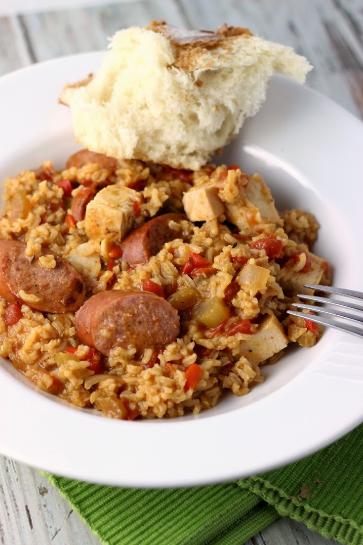 Chicken and Sausage Jambalaya in a white bowl with bread