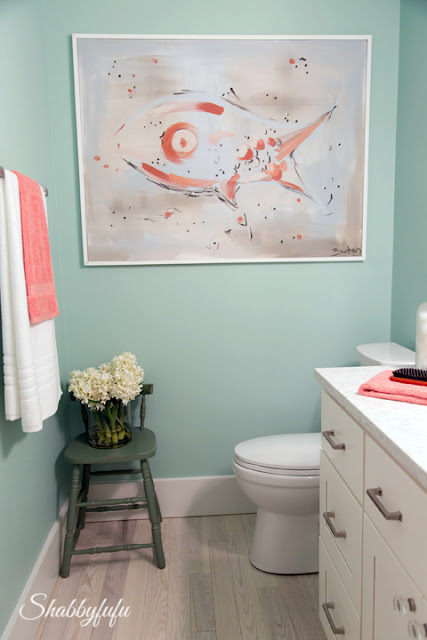 Bathroom in the HGTV Dream Home 2016 - these coastal colors continue with this mint green wall color, accented with touches of coral.