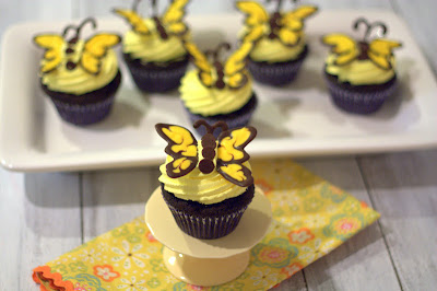 Butterfly cupcakes on a serving platter