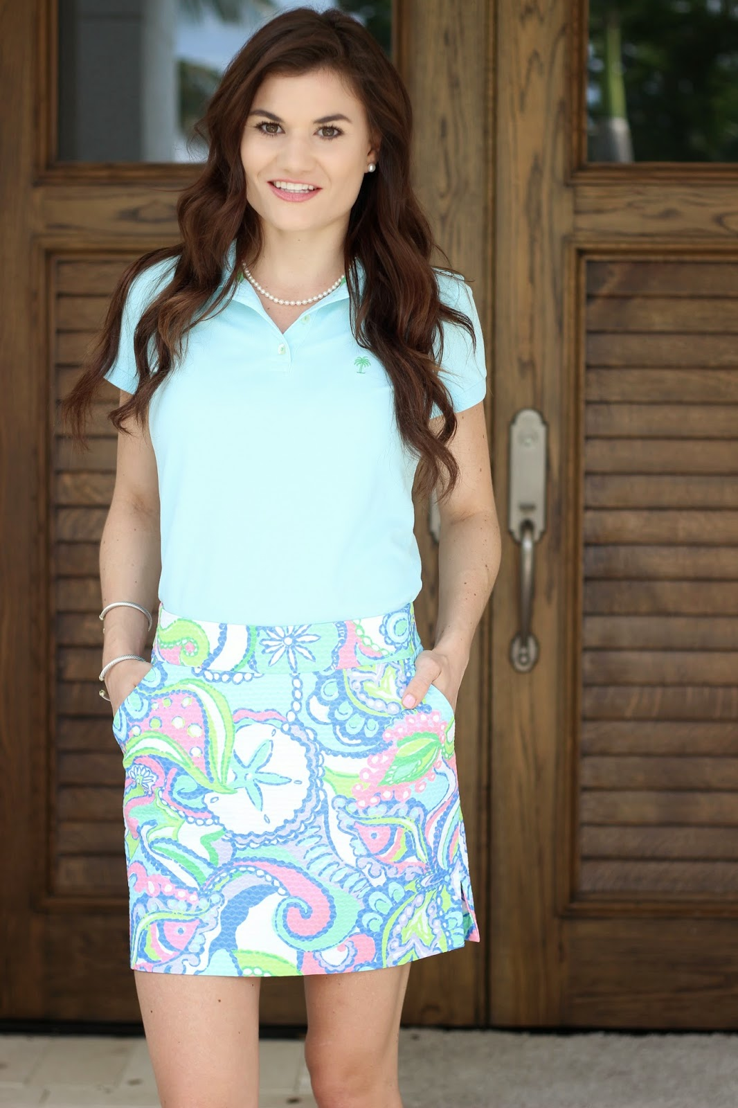 Lilly Pulitzer polo and skort for golfing