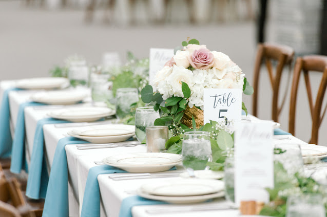 Blue table setting at reception