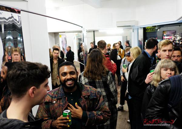 Art crowd at Alaska Projects - Street Fashion Sydney photographed by Kent Johnson.
