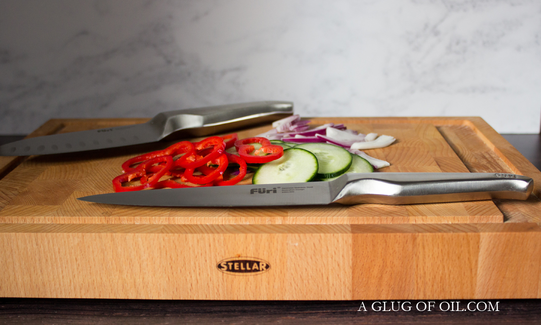 Furi knives on wooden chopping board