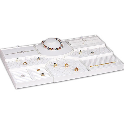 Use the white faux leather combination jewelry display perfectly fit in a glass table display.