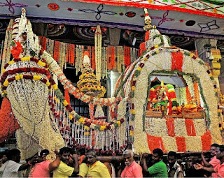 The flower decorated palanquin (poo-pallakku) of goddess Meenakshi taken out in a procession in the evening of 10th day of the Chithirai festival