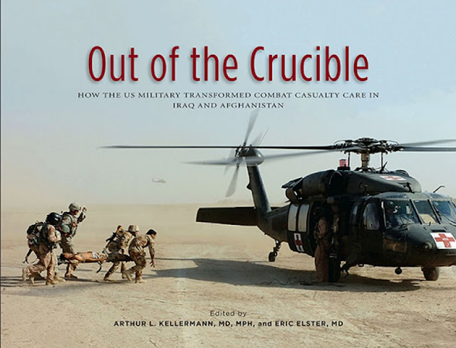"""More than 110 authors contributed to 44 chapters in the new Borden Institute book, """"Out of the Crucible:  How the U.S. Military Transformed Combat Casualty Care in Iraq and Afghanistan.""""  Dr. Art Kellermann, dean of USU's F. Edward Hebert School of Medicine, and Navy Capt. (Dr.) Eric Elster, chair of the USU-WRNMMC Department of Surgery, co-edited the book.  (Image credit: courtesy of Borden Institute)"""